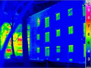 A thermal image of a building. Thermal imaging surveys can identify where heat is being lost from buildings & heat distribution systems. It can also be used to identify faults in other areas including electrical, mechanical and plumbing systems.